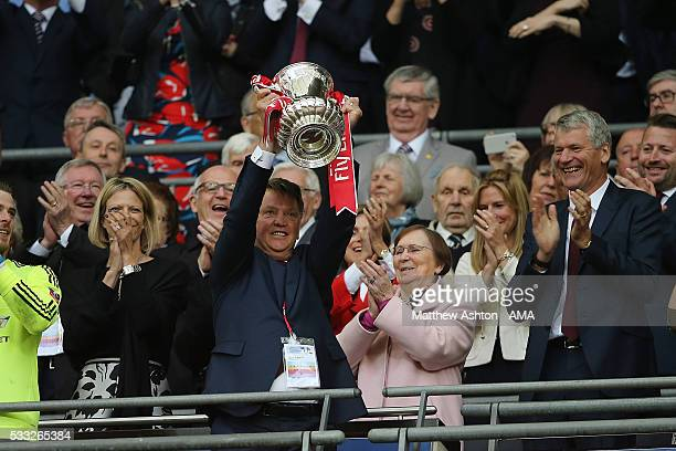 Manchester United Managr Louis van Gaal lifts the trophy following his side's 1-2 victory at the end of extra time during The Emirates FA Cup final...