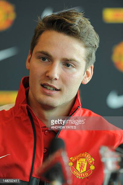Manchester United new signing English midfielder Nick Powell attends a press conference with Manchester United manager Alex Ferguson at Old Trafford...