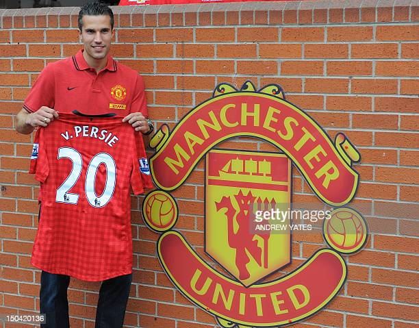 Manchester United new signing Robin Van Persie poses at Old Trafford in Manchester northwest England on August 17 Van Persie signed from Arsenal for...