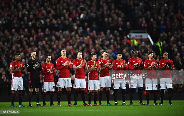 Manchester United palyers applaud as they remember exEngland manager Graham Taylor who passed away at the age of 72 on Thursday prior to the Premier...