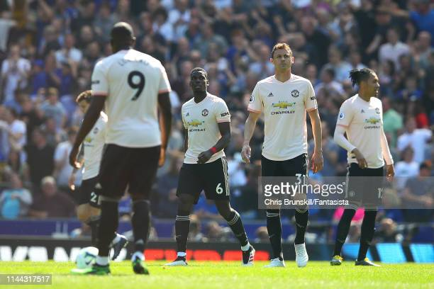 Manchester United platers react following Everton's first goal during the Premier League match between Everton FC and Manchester United at Goodison...
