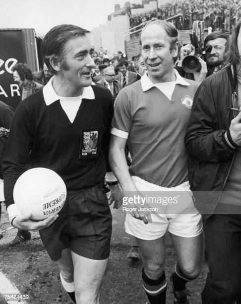 Manchester United player Bobby Charlton at Stamford Bridge with referee John Yates before a league match against Chelsea, 28th April 1973. It was...