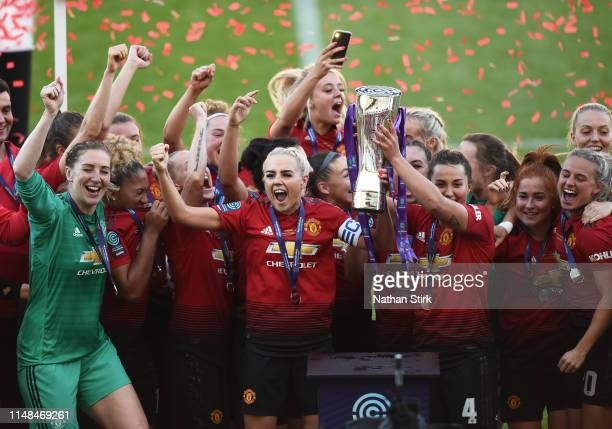Manchester United player celelbrate after they win Women's Super League 2 trophy after the match between Manchester United Women and Lewes Women at...
