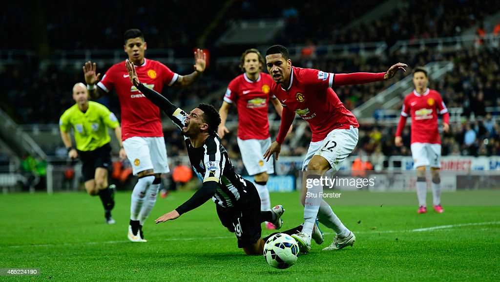 Manchester United player Chris Smalling (r) challenges Emmanuel Riviere of Newcastle in the penalty area during the Barclays Premier League match between Newcastle United and Manchester United at St James' Park on March 4, 2015 in Newcastle upon Tyne, England.