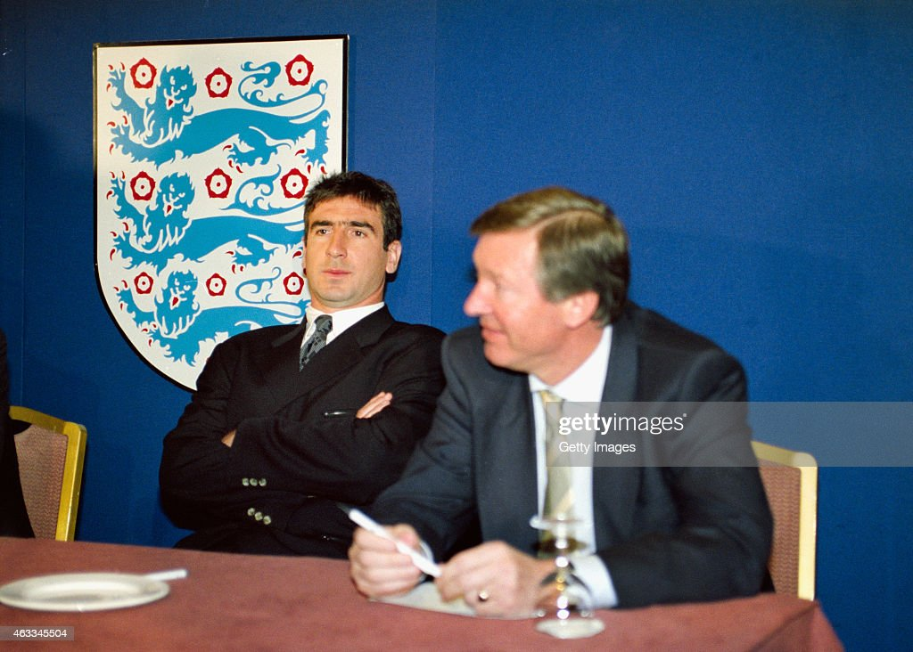 Manchester United player Eric Cantona (l) and manager Alex Ferguson, pictured at an FA disciplinary hearing after Cantona was sent off for kicking Crystal Palace player Richard Shaw and on his way back to the changing room he leapt over the barrier and attacked Palace fan Matthew Simmons, who had been using abusive language to the Frenchman, with a two-footed kung-fu type assault, at FA Headquarters on February 24, 1995 in London, England.