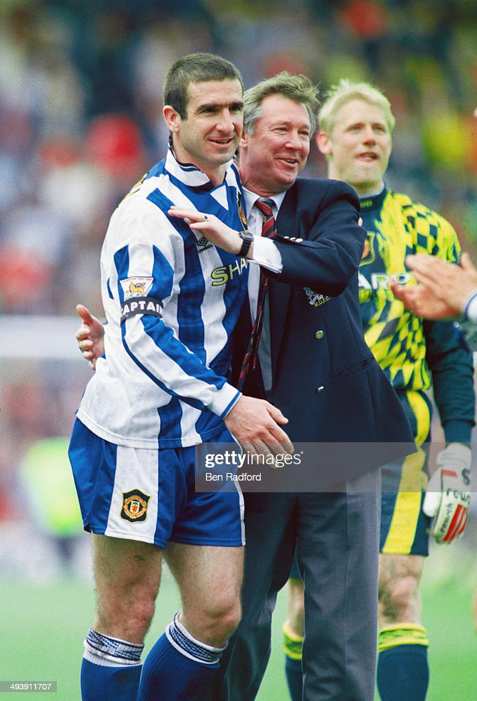 Manchester United player Eric Cantona ( left) and manager Alex Ferguson celebrate after Manchester United claim the title after the FA Premier League match between Middlesbrough and Manchester United at the Riverside on May 5, 1996 in Middlesbrough, England.
