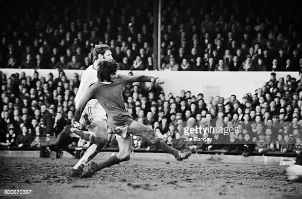 Manchester United player George Best scores during a match against Northampton Town UK 7th February 1970