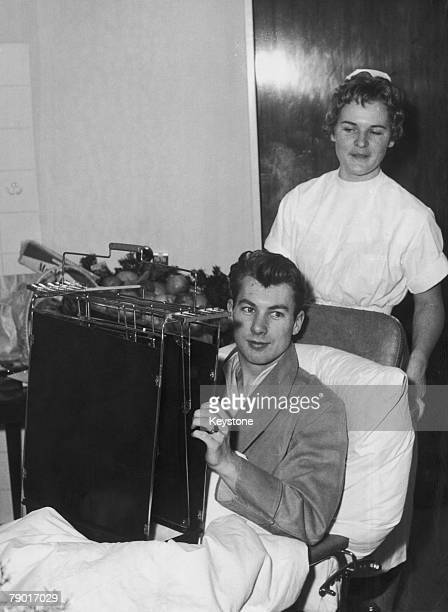 Manchester United player Ken Morgans in a wheelchair on his way to the xray room at the Isar Hospital in Munich where he is recovering from injuries...