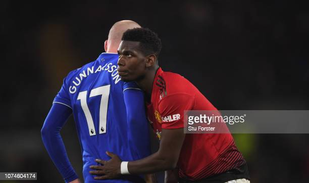 Manchester United player Paul Pogba embraces Aron Gunnarsson of Cardiff after a challenge during the Premier League match between Cardiff City and...