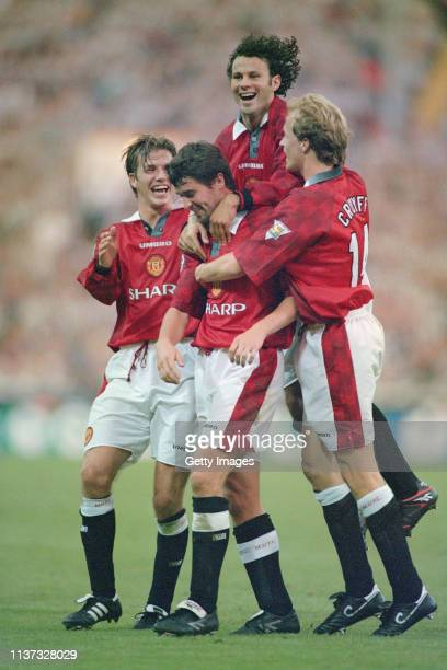 Manchester United player Roy Keane is congratulated by David Beckham Ryan Giggs and Jordi Cruyff after scoring in the 4-0 FA Charity Shield victory...