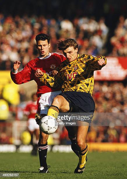 Manchester United player Ryan Giggs challenges Arsenal player Colin Pates during a Division One match between Manchester United and Arsenal at Old...