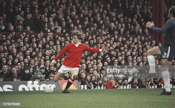 Manchester United player Sammy McIlroy prepares to cross the ball despite the attentions of Chelsea defender Ron Harris during a First Divison match...