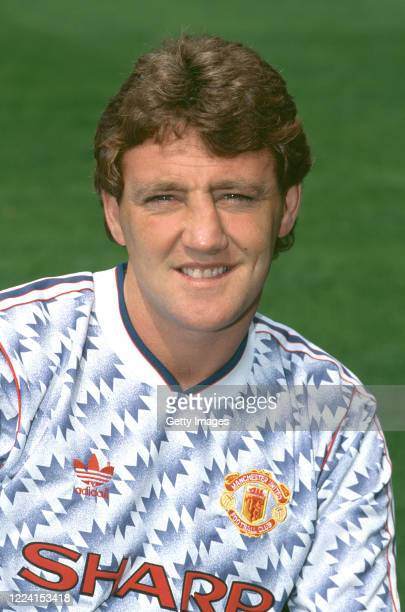 Manchester United player Steve Bruce pictured in the Blue and white Adidas away kit ahead of the 1991/92 season in Manchester, United Kingdom.