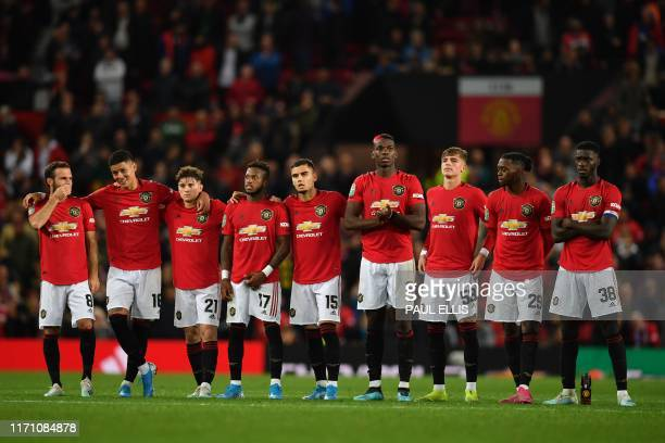 Manchester United player wait in the centre circle as penalties are taken after the game finishes 11 during the English League Cup third round...