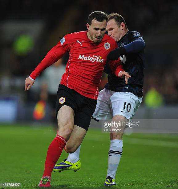 Manchester United player Wayne Rooney clashes with Jordon Mutch for a challenge which Rooney is booked during the Barclays Premier League match...