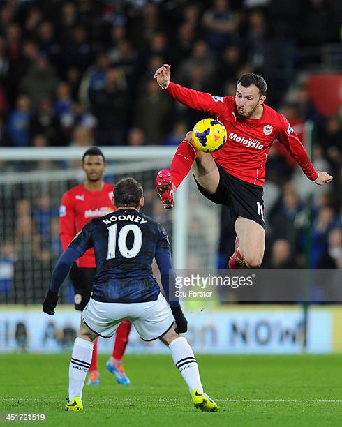 Manchester United player Wayne Rooney is beaten to the ball by Jordon Mutch during the Barclays Premier League match between Cardiff City and...