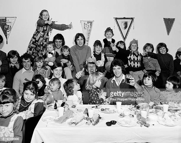 Manchester United players and their families enjoying the annual Christmas Party at Old Trafford in Manchester circa December 1975 Seated at the...
