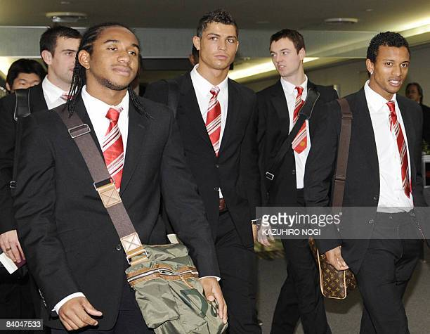 Manchester United players Anderson of Brazil Cristiano Ronaldo of Portugal Nami of Portugal and their teammates arrive at Narita International...