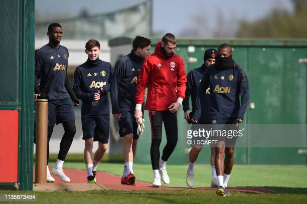 Manchester United players arrive to attend a training session at the Carrington training ground in greater Manchester north west England on April 9...