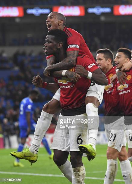 Manchester United players Ashley Young celebrates with Paul Pogba after the 5th goal during the Premier League match between Cardiff City and...