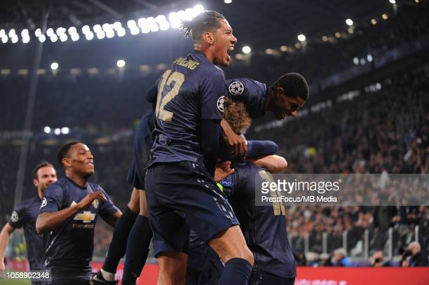 Manchester United players celebrate after Alex Sandro of Juventus scores an own goal during the Group H match of the UEFA Champions League between...