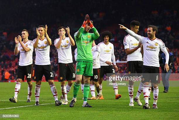Manchester United players celebrate after the Barclays Premier League match between Liverpool and Manchester United at Anfield on January 17 2016 in...