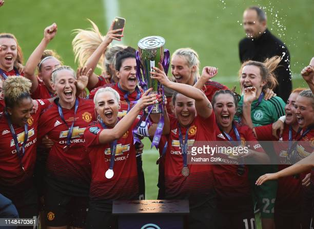 Manchester United players celebrate after they win Women's Super League 2 trophy after the match between Manchester United Women and Lewes Women at...