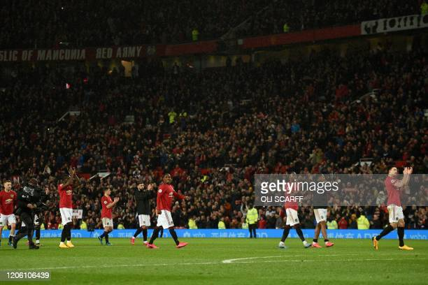 Manchester United players celebrate after winning the English Premier League football match between Manchester United and Manchester City at Old...
