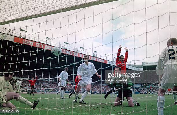 Manchester United players celebrate an own goal by Leeds United keeper Nigel Martyn during an English Premier League match at Elland Road Leeds 7th...