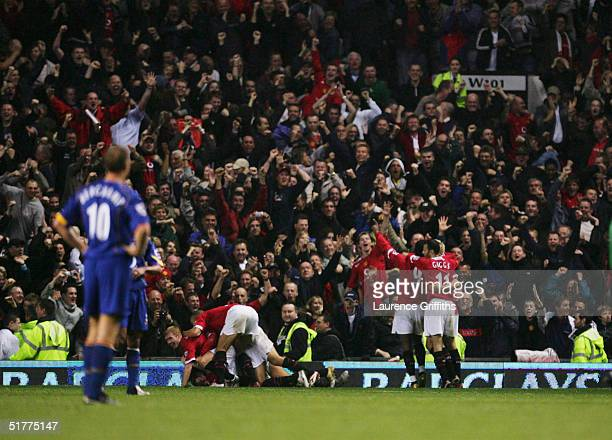 Manchester United players celebrate during the FA Barclays Premiership match between Manchester United and Arsenal at Old Trafford on October 24 2004...