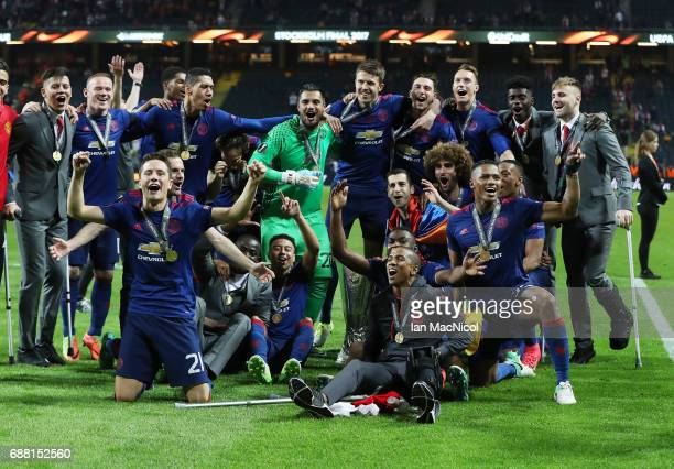 Manchester United players celebrate during the UEFA Europa League Final match between Ajax and Manchester United at Friends Arena on May 24 2017 in...