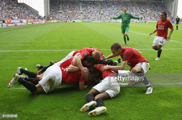 Manchester United players celebrate Ryan Giggs scoring their second goal during the Barclays FA Premier League match between Wigan Athletic and...