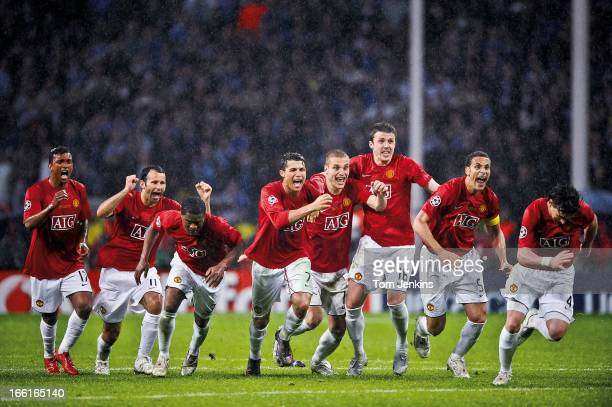 Manchester United players celebrate the moment they win the penalty shootout against Chelsea in the Champions League Final at the Luzhniki Stadium on...