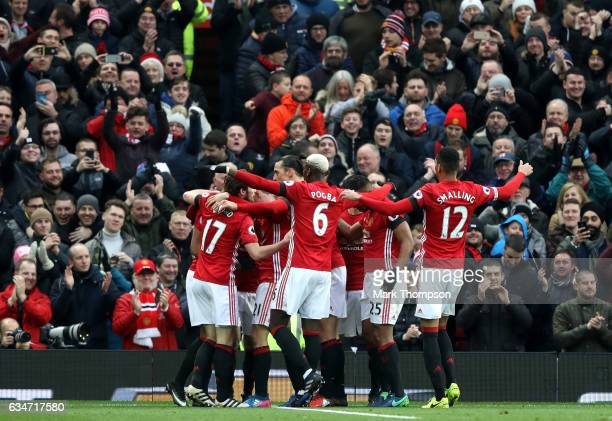 Manchester United players celebrate their first goal by Juan Mata during the Premier League match between Manchester United and Watford at Old...
