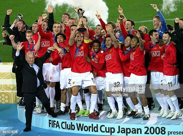 Manchester United players celebrate their victory as Rio Ferdinand of Manchester United holds up a trophy at a ceremony after the FIFA Club World Cup...