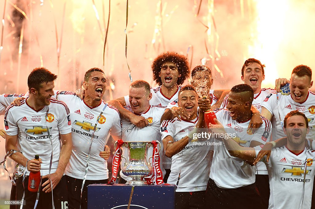 Manchester United players celebrate victory with the trophy after The Emirates FA Cup Final match between Manchester United and Crystal Palace at Wembley Stadium on May 21, 2016 in London, England. Man Utd won 2-1 after extra time.