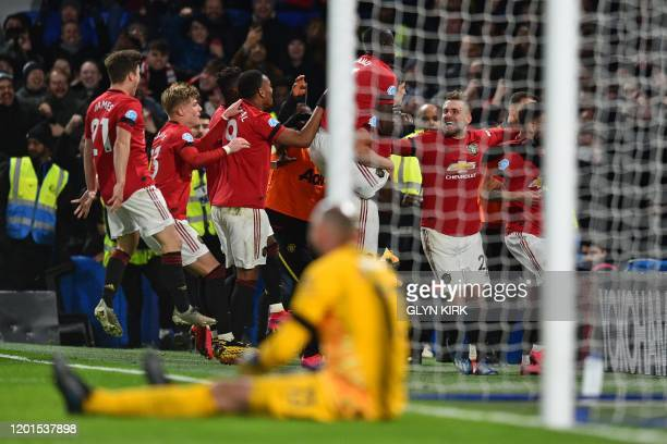 Manchester United players celebrate with Manchester United's English defender Harry Maguire after he scores their second goal during the English...