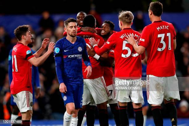 Manchester United players celebrate with Manchester United's French striker Anthony Martial after he scores the opening goal of the English Premier...