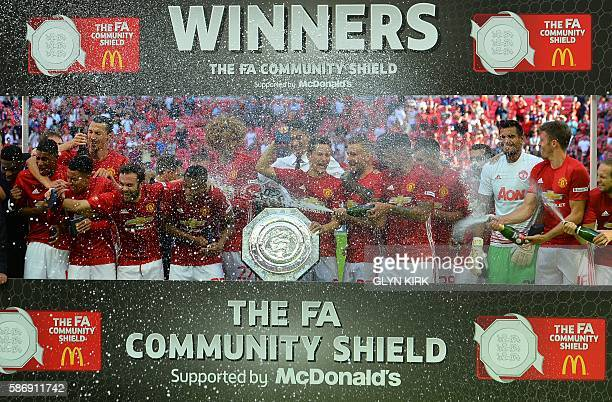 Manchester United players celebrate with the Community Shield during the trophy presentation after Manchester United beat Leicester City in the FA...