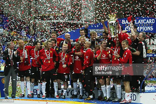 Manchester United players celebrate with the trophy after the FA Barclaycard Premiership match between Everton and Manchester United held on May 11...