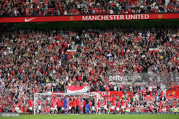 Manchester United players do a lap of honour at Old Trafford after the game