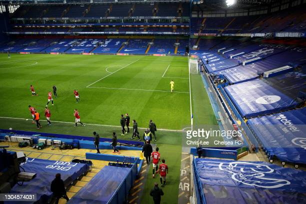 Manchester United players enter the pitch from a temporary dressing room prior to the Premier League match between Chelsea and Manchester United at...