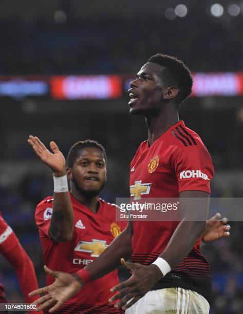 Manchester United players Fred and Paul Pogba celebrate after the 5th United goal during the Premier League match between Cardiff City and Manchester...