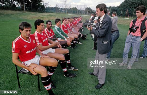 Manchester United players from left to right Graeme Hogg Paul McGrath Viv Anderson Chris Turner and Norman Whiteside look on as photographer Bob...