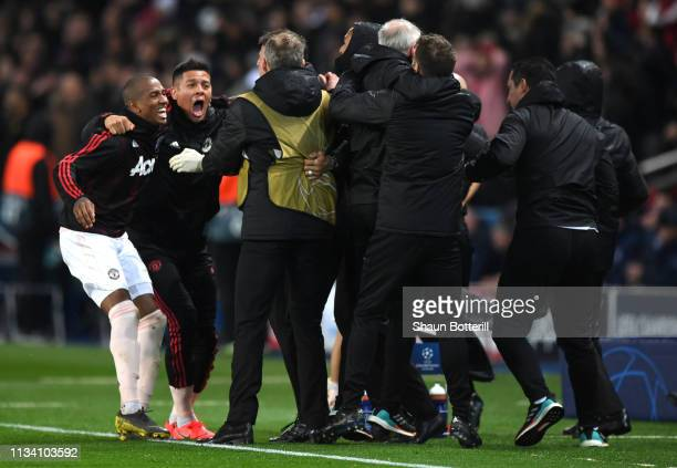 Manchester United players including Ashley Young and Marcos Rojo celebrate after Marcus Rashford scores his sides third goal during the UEFA...