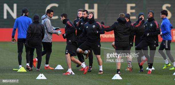 Manchester United players including Manchester United's Spanish goalkeeper David de Gea Manchester United's Armenian midfielder Henrikh Mkhitaryan...