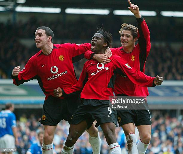 Manchester United players John O'Shea Louis Saha and Ronaldo celebrate after Saha scored the secod goal for United during the FA Barclaycard...