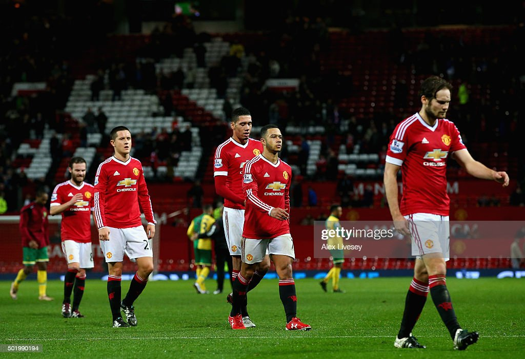 Manchester United players leave the pitch after their team's 1-2 defeat in the Barclays Premier League match between Manchester United and Norwich City at Old Trafford on December 19, 2015 in Manchester, England.