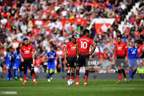 Manchester United players look dejected after conceding a second goal during the Premier League match between Manchester United and Cardiff City at...