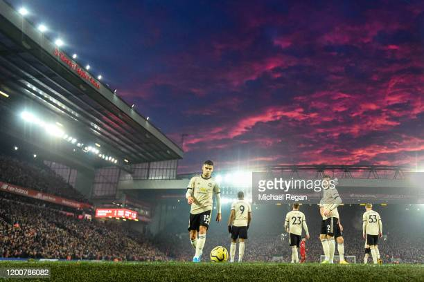 Manchester United players look dejected after the first Liverpool goal during the Premier League match between Liverpool FC and Manchester United at...